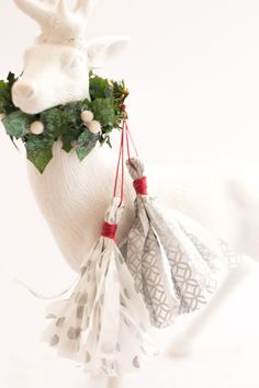 Make these DIY tissue paper fringe tassels for a fabulous gift topper, as whimsical decor or a festive ornament.