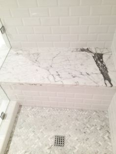 Use of cheaper subway tile on wall with a touch of marble. (Like the look, but would want a hint more color)