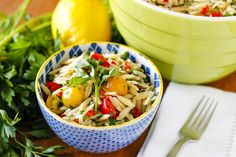 Lemony Basil Orzo Pasta Salad -- this healthy orzo salad recipe is full of bright, fresh, summery flavor... Gorgeous red and yellow cherry tomatoes, bright parsley, and vibrant basil, along with a dose of fresh lemon zest and juice marry together to make the perfect side dish to share at your next gathering! | orzo salad with feta | cold orzo salad | easy orzo salad | find the recipe on unsophisticook.com