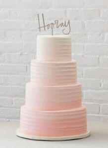 2017 Wedding Cake Trends: Ombre Wedding Cakes. Pink ombré cake iced in buttercream with a simple hooray! cake topper. Made by Whipped Bake Shop in #Philadelphia #phillyweddings #phillybakeries #phillybrides See more on our blog!