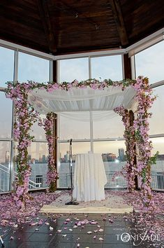 Wedding arch ideas, I could create something similar to this with 2 arches a and some chiffon or tool fabric