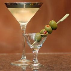 Dirty Martini: Gin, Dry Vermouth, Olive Juice, Olives.