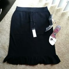 BCBG ruffled skirt Black ruffled skirt. Very ellegant and feminine. Brand new. I received it as a gift and could not return it. My loss your gain. BCBGMaxAzria Skirts Pencil