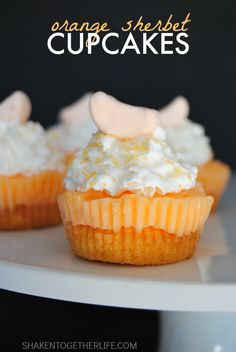 Orange Sherbet Cupcakes! Layers of fluffy orange sherbet cake, frosty orange sherbet, whipped cream, sprinkles and topped with a sweet orange marshmallow!