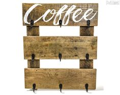 What a great way to store & display your favorite coffee mugs!  This Coffee Cup Hanger is made from reclaimed pallet wood that has been cleaned, lightly sanded & sealed. It can display up to 9 coffee mugs with its sturdy metal hooks.  You can choose from the following design options:  1- in the morning when I rise..., from the old hymn Give Me Jesus. 2- Coffee 3- Coffee - With a floral pattern 4- CUSTOM - feel free to provide your custom text at checkout for something unique or custom...