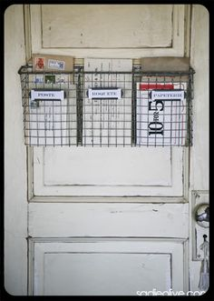 Great idea from the Old Painted Home, mount wire baskets to back of door for extra storage, looks great too!!!
