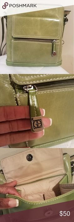 NWOT. Giani Bernini Purse Gianini Bernini - lime green genuine leather purse with 3 zipper compartments and adjustable strap. NWOT. Purse currently being sold New on line at Macy's in black for $129 -  sale for $78.00. This purse is in excellent condition. Giani Bernini Bags Shoulder Bags