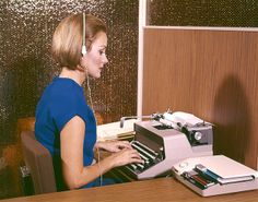 The Evolution of Women's Workwear Through the Decades. An American secretary typing whilst listening to dictation on her headset. She wears a sleeveless blue top and a blue checked skirt. Her hair is sharply cut and worn chin-length in a brushed bob. Office Fashion, New Fashion, Ladies Fashion, Fashion Bags, Permanent Waves, Shoulder Length Hair, Fashion Advice, Fashion Ideas, Fashion Inspiration
