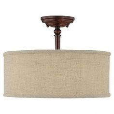 Bronzed semi-flush mount with a fabric drum shade.  Dining room light.     Product: Semi-flush mount   Construction Material: Metal   Color: Burnished nickel  Features:  Urban style   Decorative fabric shade  Accommodates: (3) 60 Watt medium incandescent base bulbs - not included  Dimensions: 11.25 H x 15 Diameter