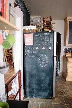 Chalkboard wall on the side of the fridge