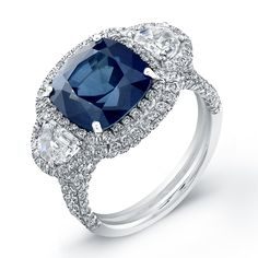 This Stunning Diamond Sapphire and Diamond Fashion Ring features a 4.80 Carat Cushion Center. LVS681