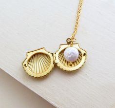 When your little one's birthstone is the pearl.  This locket, the pearl, add a picture...a true keepsake!