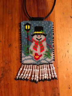 Snowman peyote necklace, saw this pattern, gave it a try