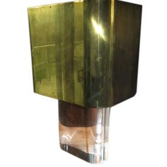 A Karl Springer Acrylic Lamp with Brass Shade | From a unique collection of antique and modern table lamps at https://www.1stdibs.com/furniture/lighting/table-lamps/