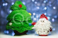 Qdiz Stock Photos | Santa Claus or Father Frost and fir tree,  #background #beard #box #celebration #Christmas #Claus #Clause #closeup #decoration #decorative #doll #eve #Father #figure #fir #frost #fun #funny #greeting #holiday #light #little #Merry #new #red #Santa #small #toy #traditional #tree #white #x-mas #xmas #year