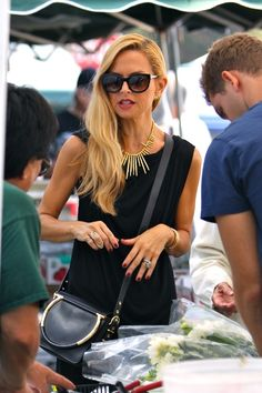 Rachel Zoe carrying a Salvatore Ferragamo Fall Winter 2014 runway collection handbag with gold Gancio icon in Los Angeles.