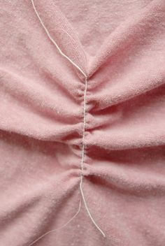 hand wind the bobbin with elastic thread, and the top thread... i never thought of that! duh. cute DIy tee transformation!