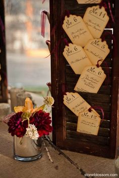 Escort Cards, which guests were asked to leave a message on and return to the couple's wishing tree.