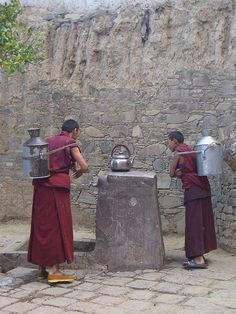 Tibet - collecting water for tea