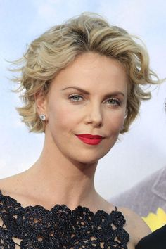 """Charlize Theron's wavy crop is a great example of adding height to a style. Cornwell recommends his clients follow Charlize's lead: """"Try some volume on top, and keep the sides softer to help balance your face shape."""" Spraying your curls back out of your face, as this style does, is one way to minimize width."""