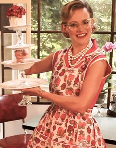 This Stacked Server is a dinner plate, bowl, salad plate and cup and saucer with four dollar store crystal candlesticks.  Make servers and centerpiece displays.  Mrs Polly Rogers how to video.