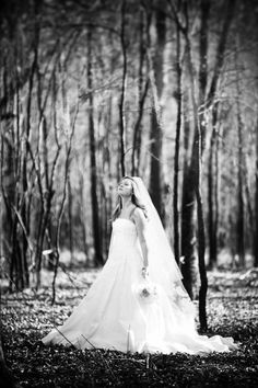 This feels almost prayer like to me.  As if she has stepped away for a moment to talk to God.  Im not sure about the blurry trees but i like the serenity in this one.    erin-bridal-portrait1