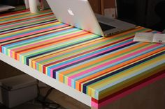 """Rainbow Tape-Topped Table, as part of """"28 Unicorn-Approved Rainbow DIYs"""""""