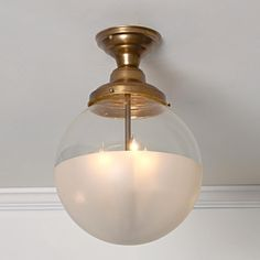 "Half and Half Glass Globe Ceiling Light: 17.25"" h x 12"" w. 3 25-watt candle sockets"
