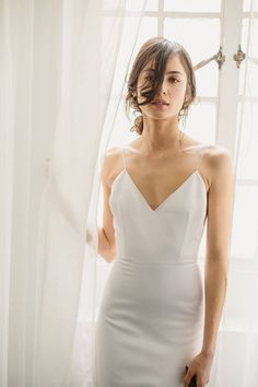 Evette by Alexandra Grecco | Classics Collection | The Evette Slip Gown is a sophisticated and sleek look. The clean, simple lines of the V neck and deep V back make this 100% silk double face satin gown feel timeless, yet incredibly modern | Inquire about the dress at our Portland and Minneapolis a&bé bridal shop locations. #alexandragrecco