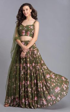 Olive green printed lehenga with blouse and mukaish stole. Fabric: Georgette Care: Dry Clean Only Gown Party Wear, Party Wear Indian Dresses, Indian Gowns Dresses, Indian Bridal Outfits, Dress Indian Style, Indian Fashion Dresses, Indian Designer Outfits, Indian Wear, Designer Dresses