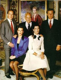 From left to right: Prince Albert, Princess Stephanie, Prince Rainier and Caroline's second husband Stefano Casiraghi. A painting of Princess Grace is looking over them.