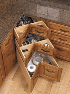 217509856975650182 GENIUS!!! Storage Corner Drawers by a company called Blum....way better than a lazy susan WHY doesnt my kitchen have these?!?!? Instead I get an abyss or two...