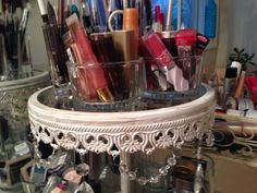 There are chandelier tear drop crystals and pretty chains around the edges of each tier.