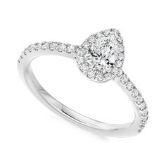 Platinum 0.63ct pear diamond with halo surround engagement ring | Diamonds | Fraser Hart Jewellers | http://www.fraserhart.co.uk/platinum-0-63ct-pear-diamond-with-halo-surround-engagement-ring.html