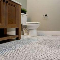 Custom Powder Bathroom with hexagon tile floor | Highland Homes