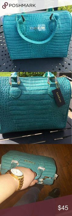 BEBE NEW Purse TEAL Brand new purse teal  *comes with strap Beautiful turquoise color.  Very feminine and great handbag :)  Price firm bebe Bags Satchels