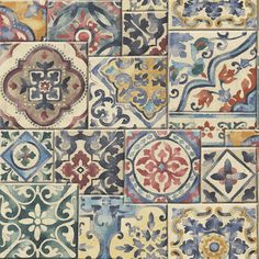 Traditional Mediterranean and arabesque red, blue green and yellow tile design wallpaper that is evocative of Morocco. Beautiful Marrakesh tiles on a flat background.