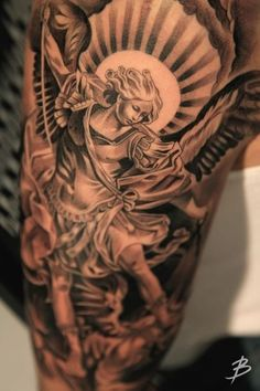 8 Powerful & Protective Archangel Michael Tattoos | Tattoodo.com