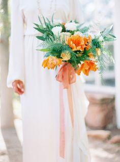 orange wedding bouquet - photo by Melissa Jill Photography http://ruffledblog.com/greenhouse-garden-wedding-inspiration