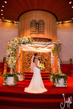 Asymmetrical birch Chuppah highlighted by bright yellow and white flowers.  photo credit: Hal Jaffe