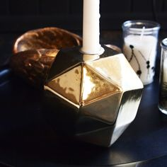 Gold Geo Candle Holder - This Candle holder is bang on trend with its geometric angles and rich metalic finish.