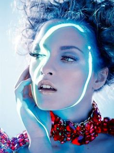 ID magazine, light painting, portait, blue tones, fashion photography, jewellery or beauty photography, blue light contrasting with red feature.