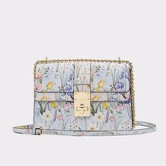 e6ac5965a1 Cerano Sweet florals pair with structured hardware on this structured cross  body bag. Bow detailing with chain adds just the right touch of edge to  femmy ...