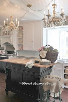 Courtney at French Country Cottage took her 1940's vintage kitchen and turned it into a fantastic French country kitchen - with chandeliers. Girly & I love!