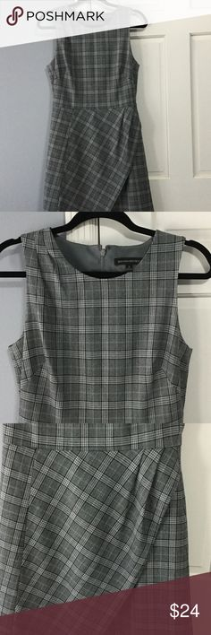 Size 8 Banana Republic dress Perfect work dress from Banana Republic fully lined.  Adorable subtle plaid dress from Banana Republic the fit is so flattering and the bottom skirt section is fun with the crossover detail.  Looks great with heels or boots.  Can dress it up or down.  Super comfortable and can work with a grey, black or tan blazer! Banana Republic Dresses