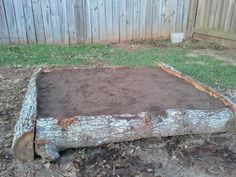Love the use of an old tree to frame this raised bed.