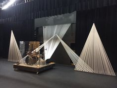 Stage design idea: Interesting shapes made with white flagging tape. Can be light with colored spotlights or can use different color tape