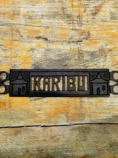 """Welcome"" Sign (Swahili) - hand carved ebony wood by artisans in Maai Mahui, Kenya - $25"