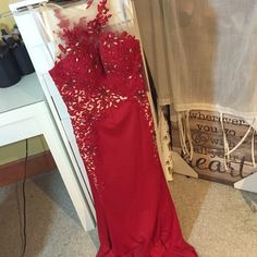 Brand New Red Jeweled Prom Dress LONG beautiful red prom dress with sheer detailing around neck. Brand new with tags, tan layer underneath. promgirl Dresses Prom