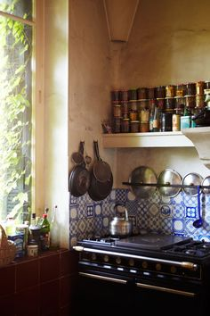 wouldn't it be nice if those tiles were handpainted and customized to you? In a witch's kitchen they could be different astrological and alchemical signs and such...